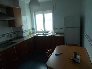 Una cocina o zona de cocina en Apartamento Ría de Ribadeo