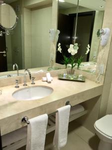 Um banheiro em Hotel Metropolitano Supara