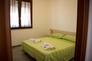 A bed or beds in a room at Case Vacanza Torre Lupa