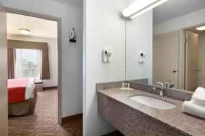 A bathroom at Super 8 by Wyndham Calgary Shawnessy Area