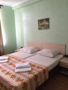 Кровать или кровати в номере Гостевой Дом Баунти