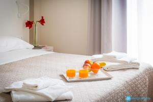 A bed or beds in a room at Hotel Amicizia