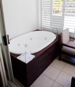 A bathroom at 3123 BEACH CLUB PARADISE