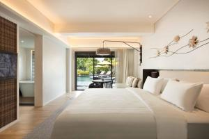 A bed or beds in a room at The ShellSea Krabi