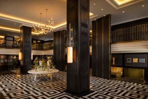 The lobby or reception area at Hilton Vienna Plaza