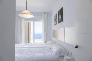 A bed or beds in a room at Mar y Sal Dream Apartments