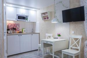 Кухня или мини-кухня в Apt on Fontanka 80 #15