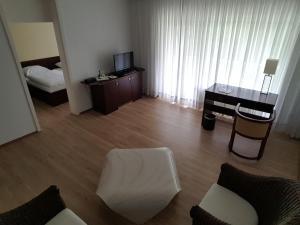 A seating area at Appart-Hotel Bad Godesberg
