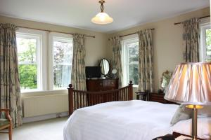 A bed or beds in a room at Garrane House
