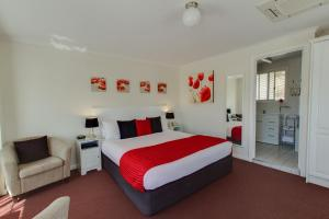 A bed or beds in a room at Clare Valley Motel