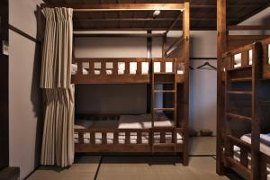 A bunk bed or bunk beds in a room at Kanazawa Guest House East Mountain