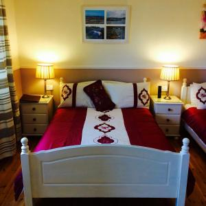 A bed or beds in a room at Clai Ban