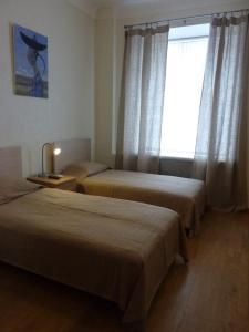 Кровать или кровати в номере Русские Апартаменты на Зубовском