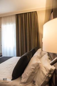 Letto o letti in una camera di Porto Cesareo Exclusive Room