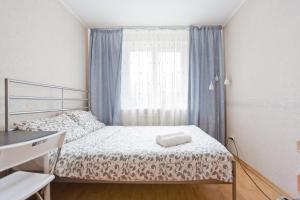 Кровать или кровати в номере Big Family Apartment in SPb
