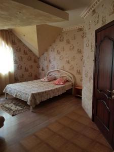 Кровать или кровати в номере Guest house Rim
