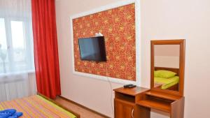 A television and/or entertainment center at Apartments on 100 Akan Seri