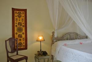A bed or beds in a room at Kilili Baharini Resort & Spa