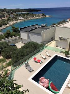 A view of the pool at Apartments Martina or nearby