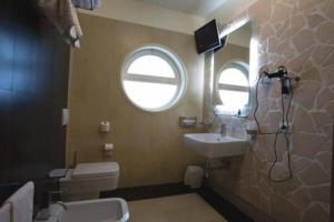 Ванная комната в Hotel Parco Dei Principi