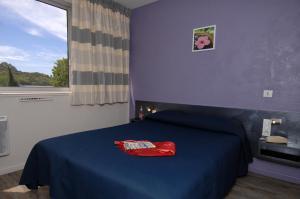 Un ou plusieurs lits dans un hébergement de l'établissement Hotel Le Lagon