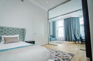 Łóżko lub łóżka w pokoju w obiekcie Craft Beer Central Hotel