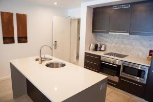 A kitchen or kitchenette at 131 Sea Temple Luxury Swimout Apt.