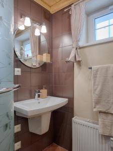 """Koupelna v ubytování Апартаменты """"Galerie BM"""""""