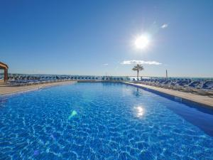 The swimming pool at or close to Golden Donaire Beach