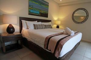 A bed or beds in a room at 132 SEA TEMPLE LUXURY DIRECT STUDIO