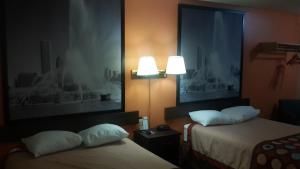 A bed or beds in a room at Super 8 by Wyndham Morris