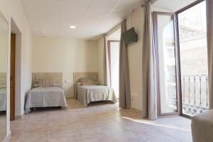 A bed or beds in a room at La Torre