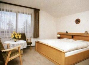 Ein Bett oder Betten in einem Zimmer der Unterkunft Neukirchener Hof