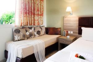 Ένα ή περισσότερα κρεβάτια σε δωμάτιο στο Blue Horizon Studios