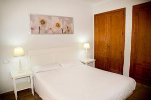 Кровать или кровати в номере Apartamentos Vista Real