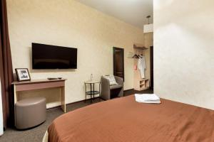 A bed or beds in a room at Shale on Komsomolsky