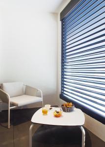 A seating area at Hôtel In Situ