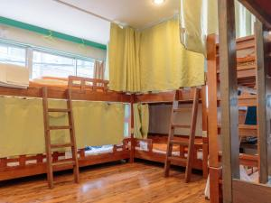 A bunk bed or bunk beds in a room at J-Hoppers Osaka Guesthouse