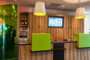 A television and/or entertainment center at ibis Styles Zeebrugge