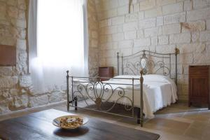 A bed or beds in a room at Masseria Asteri Resort