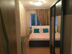 A bed or beds in a room at Apartment Курортная зона