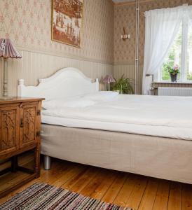 Säng eller sängar i ett rum på Enångers Bed and Breakfast