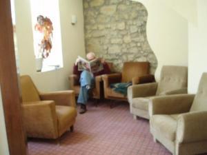 A seating area at Pensao Lourenco