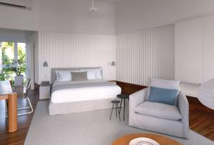 A bed or beds in a room at Lizard Island Resort