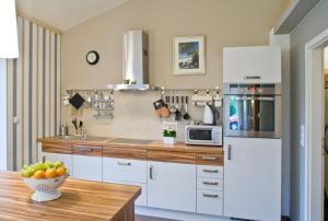 Kuchyň nebo kuchyňský kout v ubytování Gundies Home No. 15 GmbH