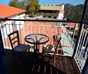 A balcony or terrace at Elyssia Hotel