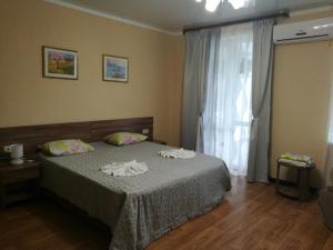 Кровать или кровати в номере Riza