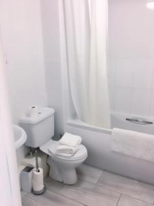 A bathroom at Charimore Executive Apartment