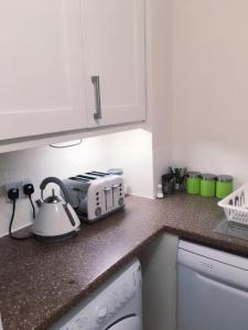 A kitchen or kitchenette at Charimore Executive Apartment