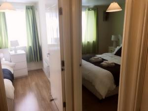 A bed or beds in a room at Charimore Executive Apartment
